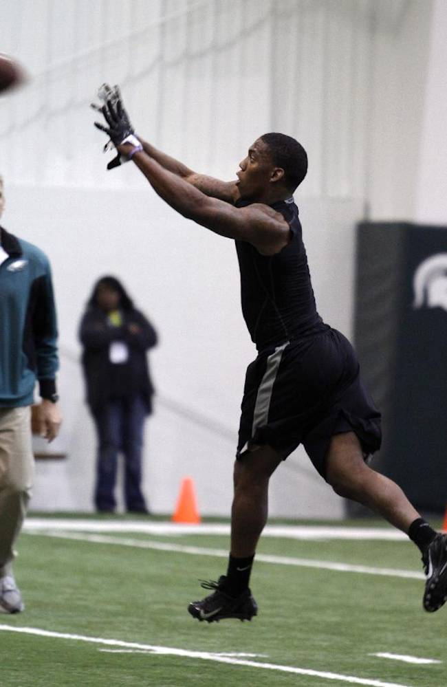 Former Michigan State cornerback Darqueze Dennard, right, runs a drill during pro day for NFL scouts, Tuesday, March 11, 2014, in East Lansing, Mich