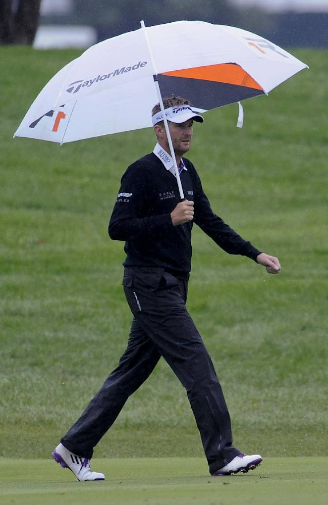 Rain keeps leaders away at BMW Championship