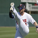 Minnesota Twins third baseman Trevor Plouffe works out on the field before an exhibition baseball game against the Boston Red Sox, Saturday, March 1, 2014, in Fort Myers, Fla The Associated Press