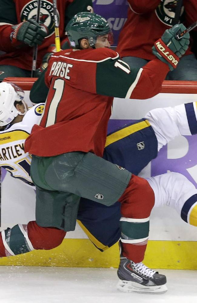 Minnesota Wild's Zach Parise (11) upends Nashville Predators' Victor Bartley into the boards and knocking the door to the Wild bench open in the third period of an NHL hockey game, Tuesday, Oct. 22, 2013, in St. Paul, Minn. The Wild won 2-0