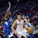 Houston Rockets' Jeremy Lin (7) drives the ball around Minnesota Timberwolves' A.J. Price (22) in the second half of an NBA basketball game Saturday, Nov. 23, 2013, in Houston. The Rockets won 112-101 The Associated Press