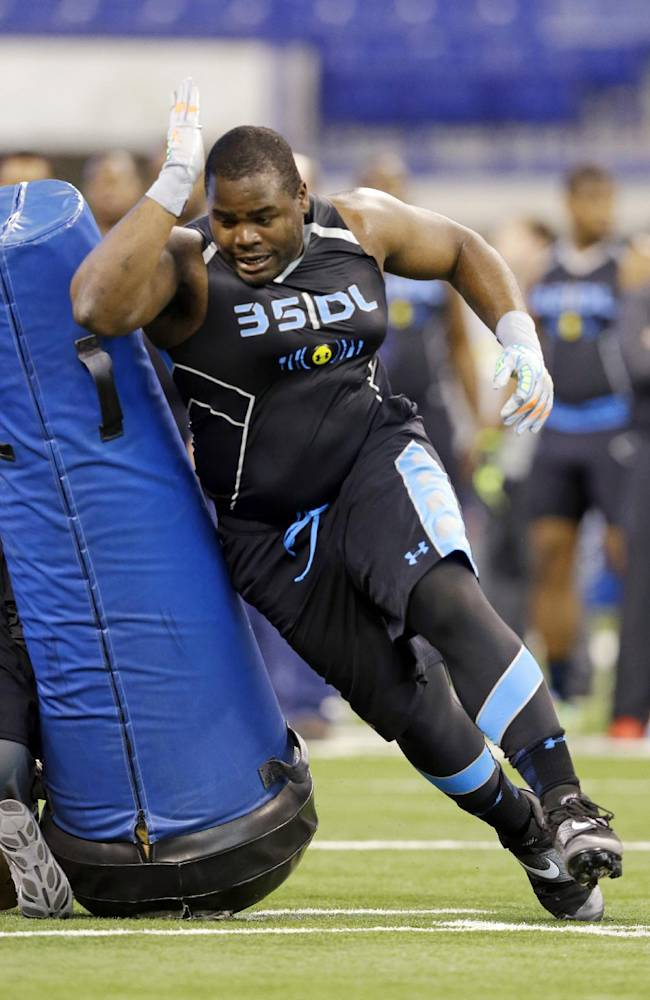 Notre Dame defensive lineman Louis Nix runs a drill at the NFL football scouting combine in Indianapolis, Monday, Feb. 24, 2014