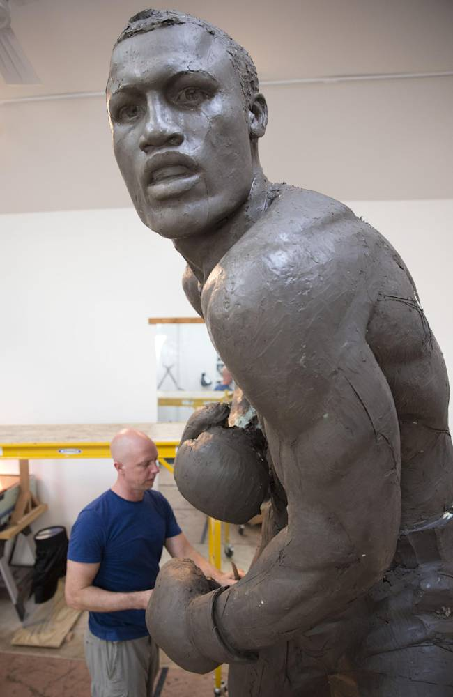 In this Aug. 14, 2014 photo, artist Stephen Layne works on a sculpture of boxing heavyweight champion Joe Frazier in Philadelphia. Next year, the sculpture is expected to be placed near the city's sports stadiums, ending a hurdle-strewn saga that included fundraising problems and the death of the original sculptor. Frazier died in 2011