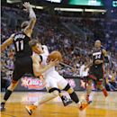 Phoenix Suns guard Goran Dragic (1) is fouled by Miami Heat forward Chris Andersen (11) during the first half of an NBA basketball game Tuesday, Feb. 11, 2014, in Phoenix The Associated Press