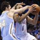 Oklahoma City Thunder guard Derek Fisher (6) is fouled by Denver Nuggets guard Evan Fournier (94) in the fourth quarter of an NBA basketball game in Oklahoma City, Monday, March 24, 2014. Oklahoma City won 117-96 The Associated Press