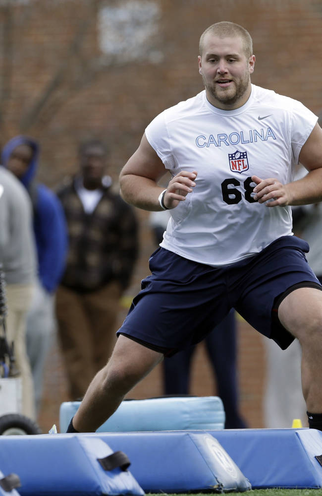 In this Tuesday, March 25, 2014 photo, North Carolina offensive tackle James Hurst participates in a drill during an NFL football pro day at the University of North Carolina in Chapel Hill, N.C. Hurst is projected as possible sixth- or seventh-round draft selection according to scouting reports
