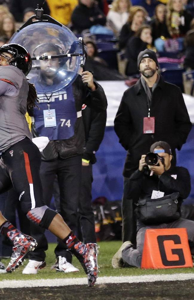 Texas Tech wide receiver Bradley Marquez grabs a pass in the end zone for a touchdown against Arizona State in the first half during the Holiday Bowl NCAA college football game Monday, Dec. 30, 2013, in San Diego