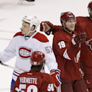 Phoenix Coyotes' Shane Doan (19) celebrates his goal with teammates Antoine Vermette (50) and Oliver Ekman-Larsson (23), of Sweden, as Montreal Canadiens' Ryan White (53) skates past during the third period of an NHL hockey game on Thursday, March 6, 2014