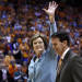 Tennessee head coach emeritus Pat Summitt waves to fans as she walks with athletic director Dave Hart before a banner is be raised in her honor before an NCAA college basketball game against Notre Dame on Monday, Jan. 28, 2013, in Knoxville, Tenn
