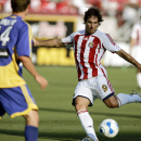 FC Dallas' Drew Moor (14) looks on as Chivas USA's Ante Razov (9) plants and makes a kick for a goal in the second half of their MLS soccer game at Pizza Hut Park in Frisco, Texas, Sunday, June 11, 2006. FC Dallas won 2-1 The Associated Press