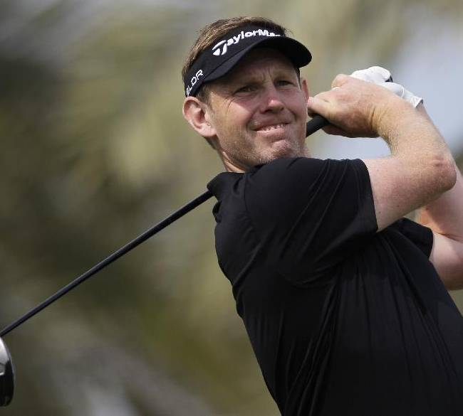 Stephen Gallacher from Scotland plays a shot off the 3rd tee during the final round of the Dubai Desert Classic golf tournament in Dubai, United Arab Emirates, Sunday Feb. 2, 2014
