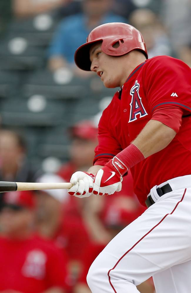 Los Angeles Angels' Mike Trout watches his single in the second inning during a spring training baseball game against the Chicago Cubs on Friday, Feb. 28, 2014, in Tempe, Ariz
