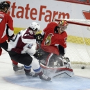 Ottawa Senators goaltender Craig Anderson (41) looks behind him as the puck goes in the net as Colorado Avalanche's Dennis Everberg (45) and Senators' Kyle Turris (7) watch during the first period of an NHL hockey game Thursday, Ocyt. 16, 2014, in Ottawa,