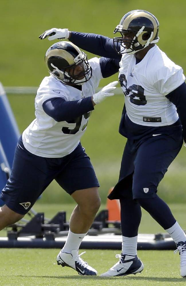 St. Louis Rams first-round draft pick Aaron Donald, left, and teammate Deantre Harlan take part in a drill during the team's NFL football rookie camp Friday, May 16, 2014, in St. Louis