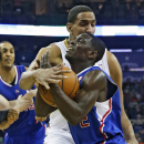 Los Angeles Clippers guard Darren Collison (2) gets wrapped up by New Orleans Pelicans center Alexis Ajinca (42) in the first half of an NBA basketball in New Orleans, Monday, Feb. 24, 2014 The Associated Press