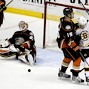 Boston Bruins left wing Brad Marchand, right, celebrates his goal past Anaheim Ducks goalie Frederik Andersen, left, and Ryan Getzlaf during the second period of an NHL hockey game in Anaheim, Calif., Monday, Dec. 1, 2014 The Associated Press
