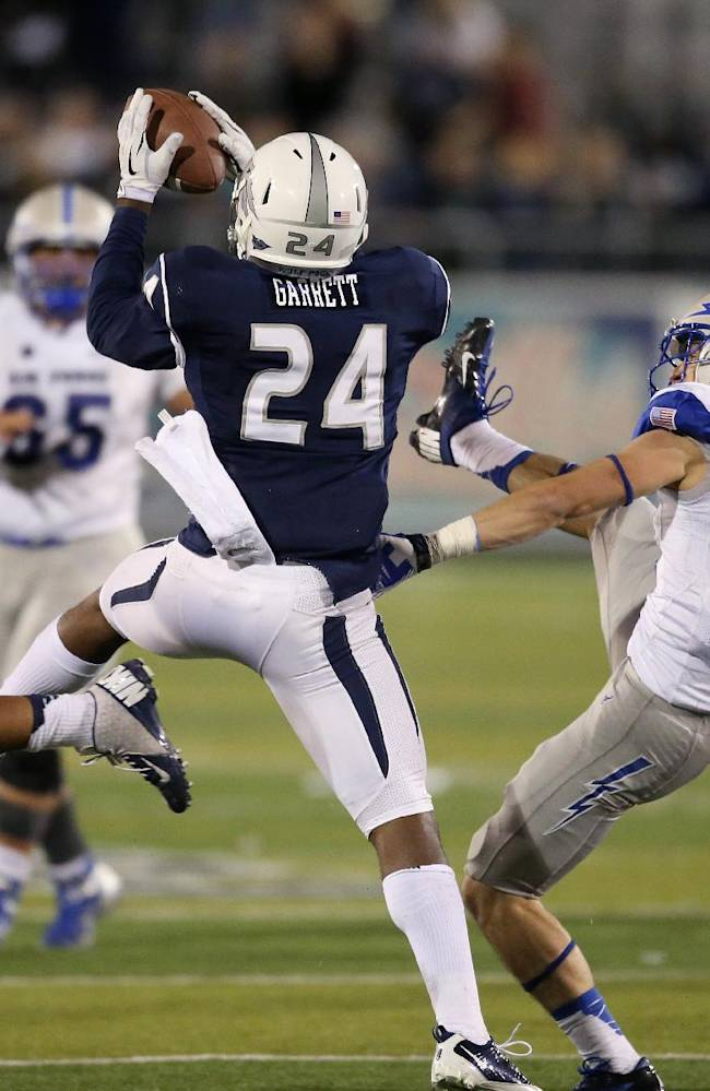 Nevada's Charles Garrett (24) intercepts a pass from Air Force's Karson Roberts (16) during the second half of an NCAA football game in Reno, Nev., on Saturday, Sept. 28, 2013. The interception clinched the win in the final seconds of the game. Nevada won 45-42
