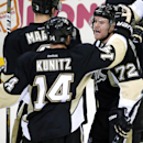 Pittsburgh Penguins' Patric Hornqvist (72) celebrates his empty-net goal with Chris Kunitz (14) during the third period of an NHL hockey game against the New York Islanders in Pittsburgh, Saturday, Oct. 18, 2014. The Penguins won 3-1 The Associated Press