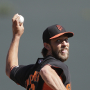 San Francisco Giants starting pitcher Madison Bumgarner pitches to a Colorado Rockies batter during the first inning of an exhibition spring training baseball game Tuesday, March 4, 2014, in Scottsdale, Ariz The Associated Press