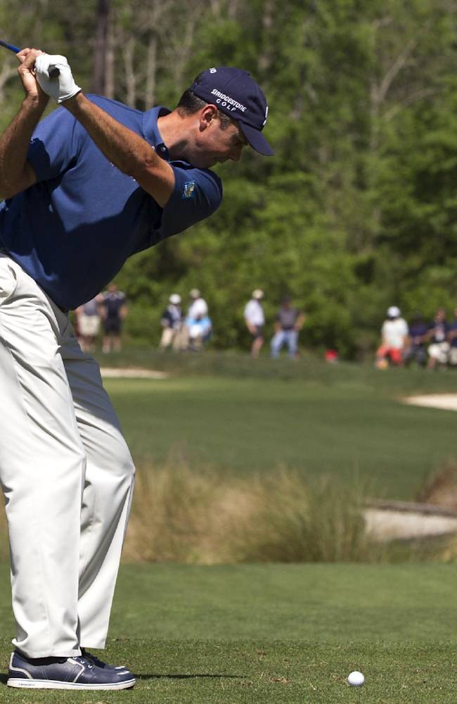 Matt Kuchar tees off on the nine hole during the second round of the Houston Open golf tournament, Friday, April 4, 2014, in Humble, Texas. (AP Photo/Patric Schneider)
