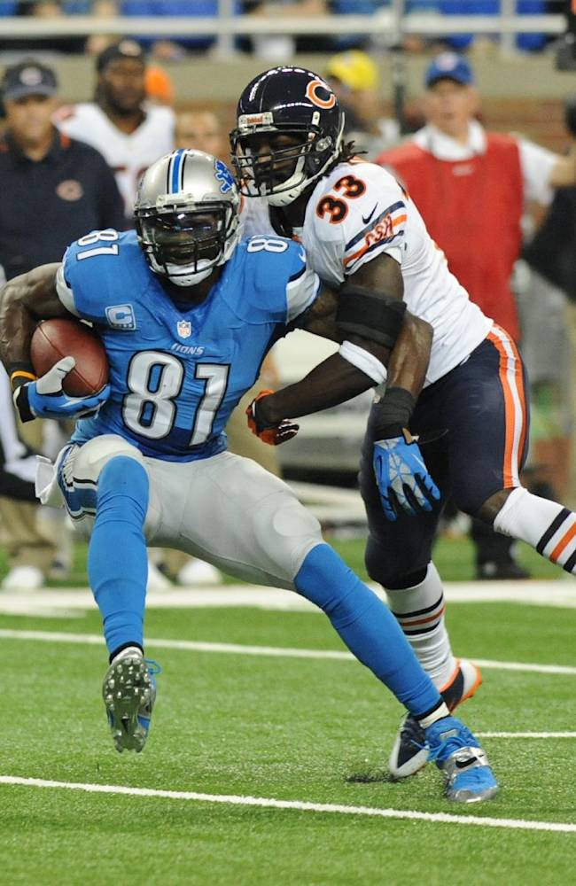 Detroit Lions wide receiver Calvin Johnson (81) makes a reception in front of Chicago Bears cornerback Charles Tillman (33) during the first quarter of an NFL football game at Ford Field in Detroit, Sunday, Sept. 29, 2013