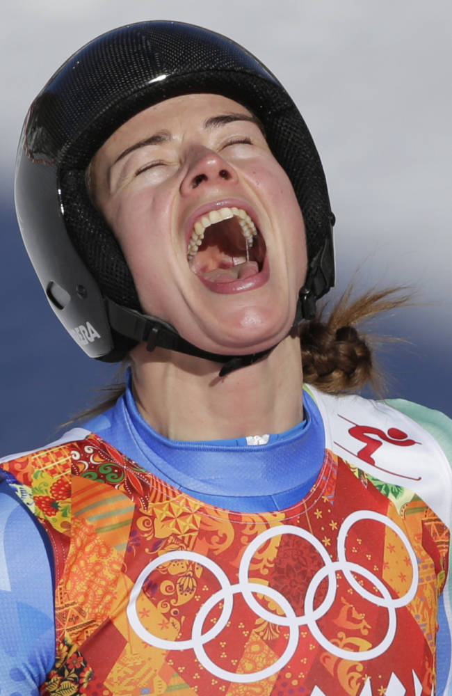 Slovenia's Tina Maze celebrates after finishing in the women's downhill at the Sochi 2014 Winter Olympics, Wednesday, Feb. 12, 2014, in Krasnaya Polyana, Russia