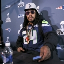 Seattle Seahawks' Marshawn Lynch sets his timer for five minutes at a news conference for NFL Super Bowl XLIX football game, Wednesday, Jan. 28, 2015, in Phoenix. The Seahawks play the New England Patriots in Super Bowl XLIX on Sunday, Feb. 1, 2015. (AP Photo/Matt York)