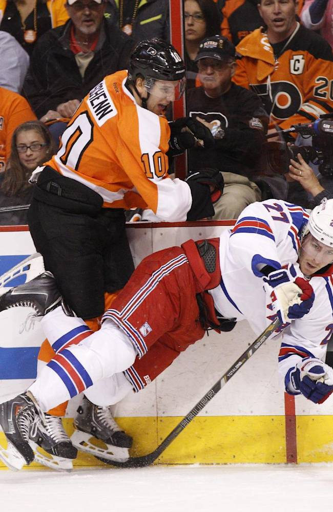 Philadelphia Flyers' Brayden Schenn, left, checks New York Rangers' Ryan McDonagh along the boards during the first period in Game 4 of an NHL hockey first-round playoff series, Friday, April 25, 2014, in Philadelphia