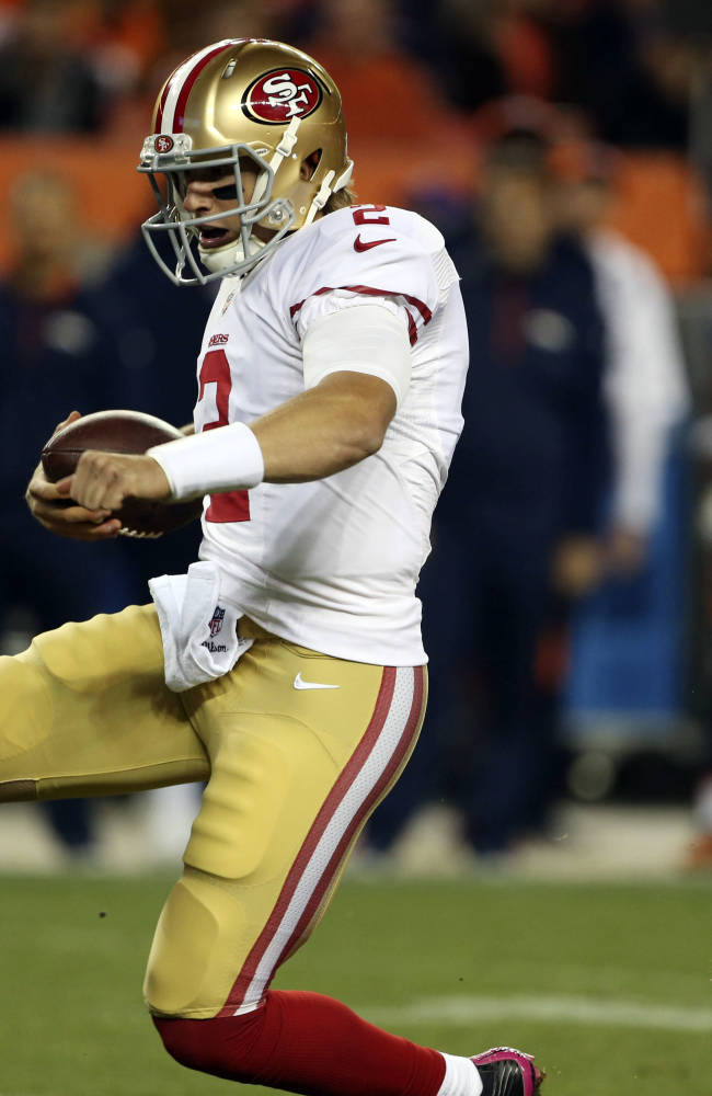 San Francisco 49ers quarterback Blaine Gabbert (2) runs against the Denver Broncos during the second half an NFL football game, Sunday, Oct. 19, 2014, in Denver. The Broncos won 42-17