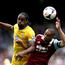 West Ham United's Winston Reid, right, and Crystal Palace's Cameron Jerome compete for the ball during the English Premier League soccer match at Upton Park, London, Saturday April 19, 2014