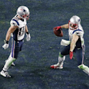 New England Patriots wide receiver Danny Amendola (80) celebrates a touchdown by New England Patriots wide receiver Julian Edelman (11) during the second half of NFL Super Bowl XLIX football game against the Seattle Seahawks Sunday, Feb. 1, 2015, in Glend