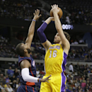 Los Angeles Lakers center Pau Gasol (16), of Spain, shoots over Detroit Pistons forward Greg Monroe during the first quarter of an NBA basketball game at the Palace in Auburn Hills, Mich., Friday, Nov. 29, 2013 The Associated Press