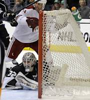 Phoenix Coyotes center Kyle Chipchura (24) is credited with an assist on this goal by center Jeff Halpern, not shown, against Los Angeles Kings goalie Jonathan Quick (32) in the third period of an NHL hockey game in Los Angeles Monday, March 17, 2014. The Coyotes won, 4-3. (AP Photo/Reed Saxon)