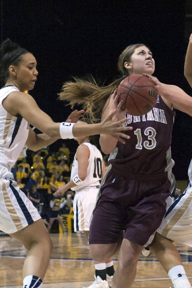 In this photo provided by Montana State University, Montana center Alycia Sims (13) looks to shoot against Montana State defenders during the first half of an NCAA college basketball game Monday, March 3, 2014, in Bozeman, Mont