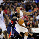 Atlanta Hawks forward DeMarre Carroll (5) attempts to get by Los Angeles Clippers forward Matt Barnes (22) during the first half of an NBA basketball game, Saturday, March 8, 2014, in Los Angeles The Associated Press