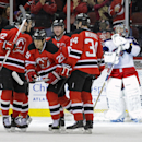 Columbus Blue Jackets goaltender Sergei Bobrovsky, right, reacts as New Jersey Devils' Eric Gelinas (22) Jon Merrill (34), Andrei Loktionov and Ryane Clowe (29) celebrate a goal by Clowe during the first period of an NHL hockey game on Thursday, Feb. 27,