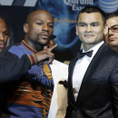 Floyd Mayweather Jr. left, and Marcos Maidana pose for photos during a news conference Wednesday, April 30, 2014, in Las Vegas. The pair square off on Saturday, May 3, for Mayweather's WBC-WBA welterweight titles. (AP Photo/Isaac Brekken)