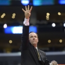 Wichita State coach Gregg Marshall signals that his team is headed to the Final Four it defeated Ohio State 70-66 in the West Regional final in the NCAA men's college basketball tournament, Saturday, March 30, 2013, in Los Angeles. (AP Photo/Mark J. Terrill)