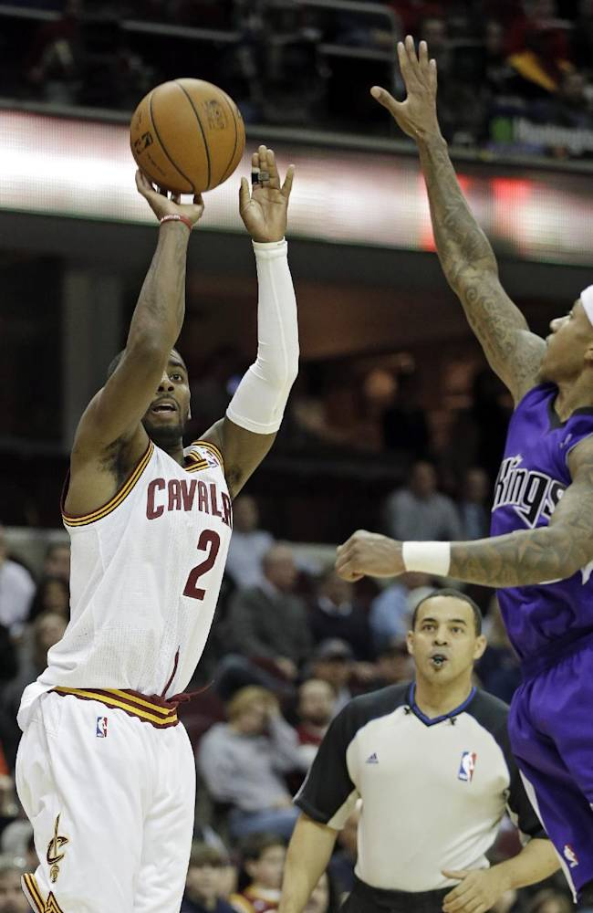 Cleveland Cavaliers' Kyrie Irving (2) makes a 3-point shot against Sacramento Kings' Isaiah Thomas during the fourth quarter of an NBA basketball game Tuesday, Feb. 11, 2014, in Cleveland. The Cavaliers won 109-99
