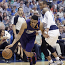 Phoenix Suns guard Gerald Green, left, drives against Dallas Mavericks guard Monta Ellis, right, during the first half of an NBA basketball game on Saturday, April 12, 2014, in Dallas The Associated Press