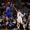 ATLANTA, GA - APRIL 3: Carmelo Anthony #7 of the New York Knicks takes a shot against Josh Smith #5 of the Atlanta Hawks on April 3, 2013 at Philips Arena in Atlanta, Georgia. (Photo by Scott Cunningham/NBAE via Getty Images)