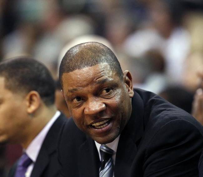 Los Angeles Clippers' head coach Doc Rivers sits on the sideline in the second half during an NBA preseason basketball game against the Utah Jazz Saturday, Oct. 12, 2013, in Salt Lake City.   The Clippers won 106-74