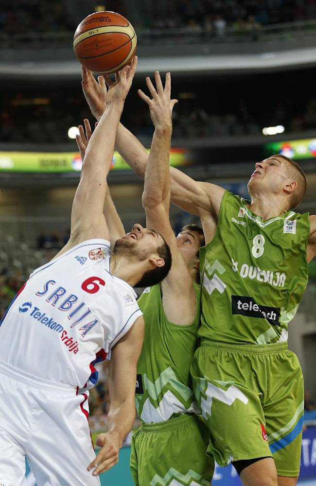 Serbia's Vasilje Micic, left, fights for a rebound with Slovenia's Goran Dragic, center, and Edo Muric during their EuroBasket European Basketball Championship classification 5th to 8th place play off match in Ljubljana, Slovenia, Thursday, Sept. 19, 2013