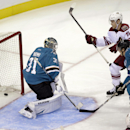 A shot from Arizona Coyotes' Justin Hodgeman, not pictured, gets past San Jose Sharks goalie Antti Niemi (31), of Finland, for a goal as Coyotes' Henrik Samuelsson (15) and Sharks' Justin Braun (61) watch during the first period of an NHL preseason hockey