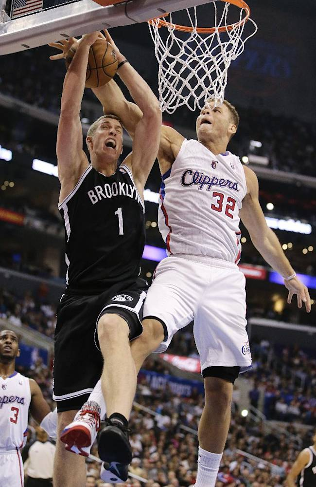 Brooklyn Nets' Mason Plumlee, left, gets his shot blocked by Los Angeles Clippers' Blake Griffin during the second half of an NBA basketball game on Saturday, Nov. 16, 2013, in Los Angeles