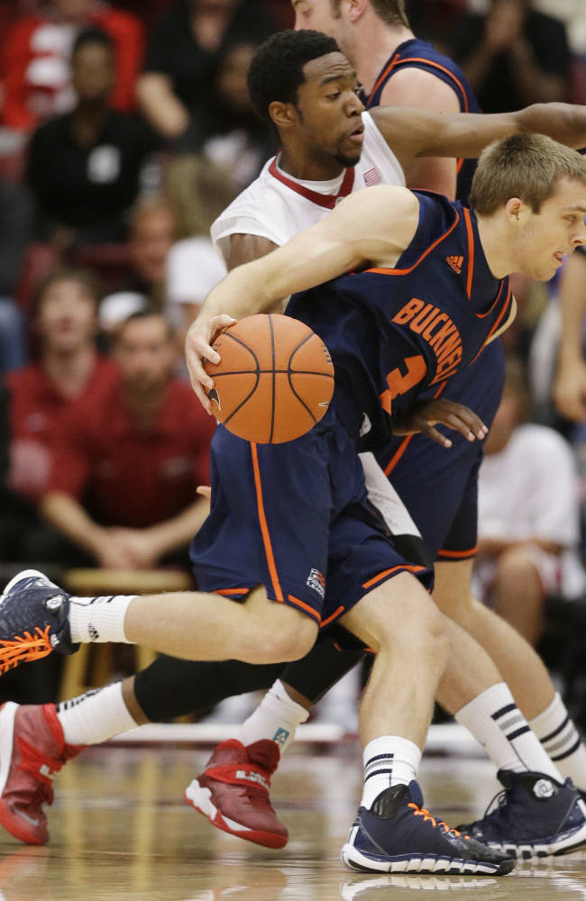 Bucknell's Steven Kaspar (3) dribbles around Stanford's Chasson Randle during the first half of an NCAA college basketball game Friday, Nov. 8, 2013, in Stanford, Calif