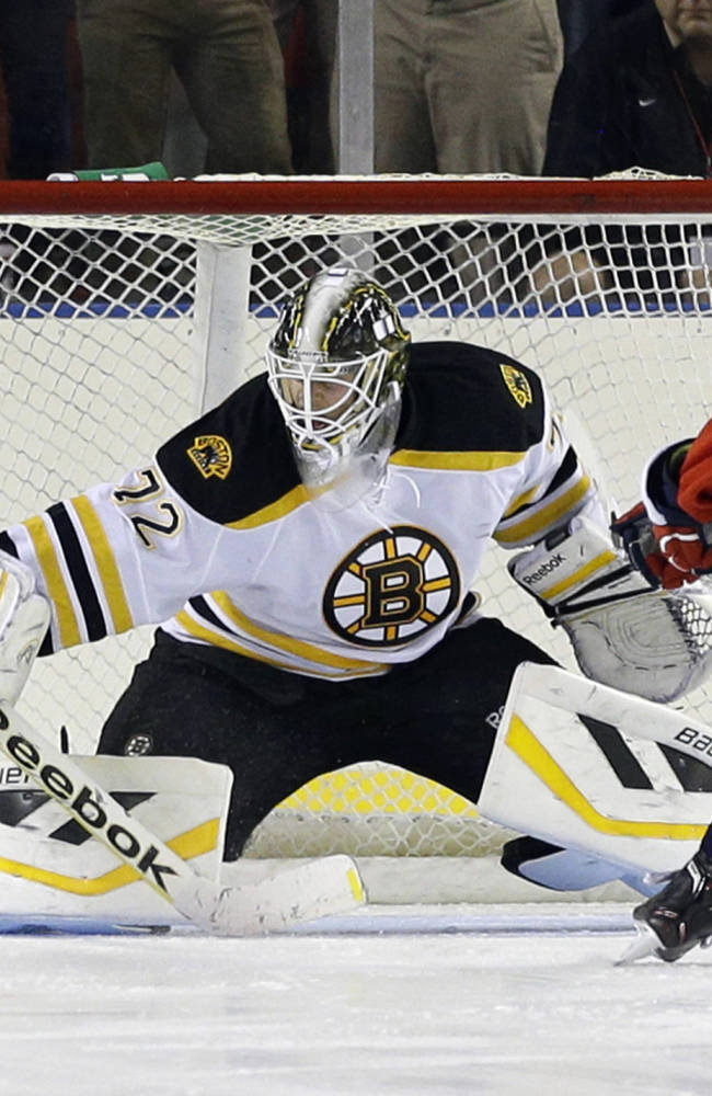 Boston Bruins goalie Niklas Svedberg, of Sweden, blocks a shot attempt by Washington Capitals' Steven Oleksy during a shootout in a preseason NHL hockey game, Tuesday, Sept. 17, 2013, in Baltimore. Boston won 3-2 in a shootout