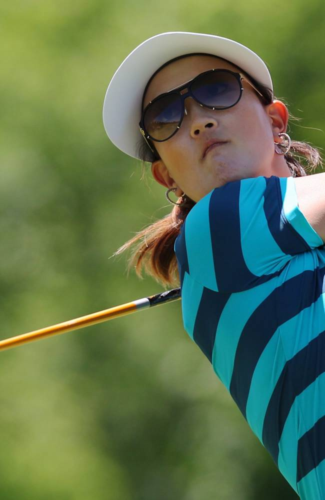 Michelle Wie watches her tee shot on the fifth hole during the third round of the Manulife Financial LPGA Classic golf tournament Saturday, June 7, 2014 in Waterloo, Ontario