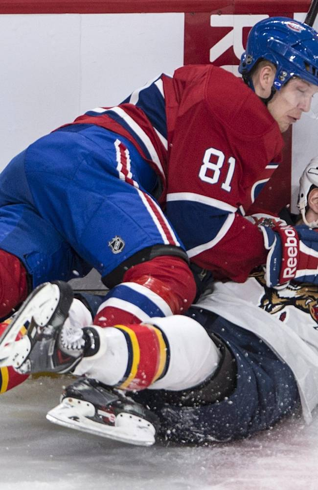 Montreal Canadiens' Lars Eller (81) falls over Florida Panthers' Aleksander Barkov during first period of an NHL hockey game, Monday, Jan. 6, 2014 in Montreal