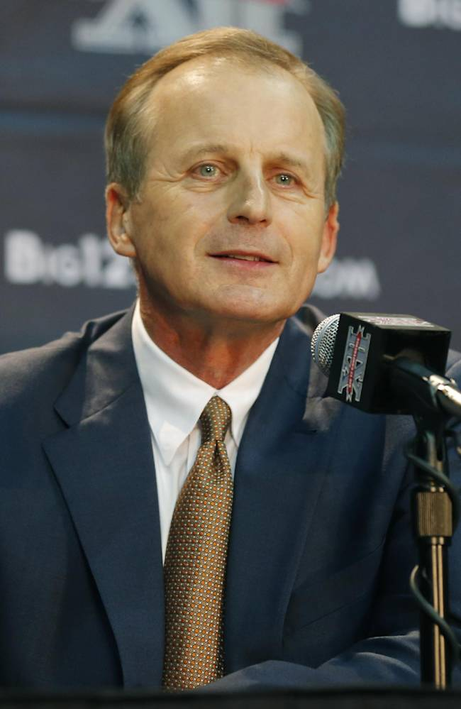 Texas coach Rick Barnes listens to a questions at a news conference during Big 12 NCAA college basketball media day in Kansas City, Mo., Tuesday, Oct. 22, 2013